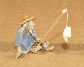 Ceramic Fisherman Figurine