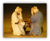 Miniature Glazed Figurine Two Men Sitting on a bench in Fine Detail